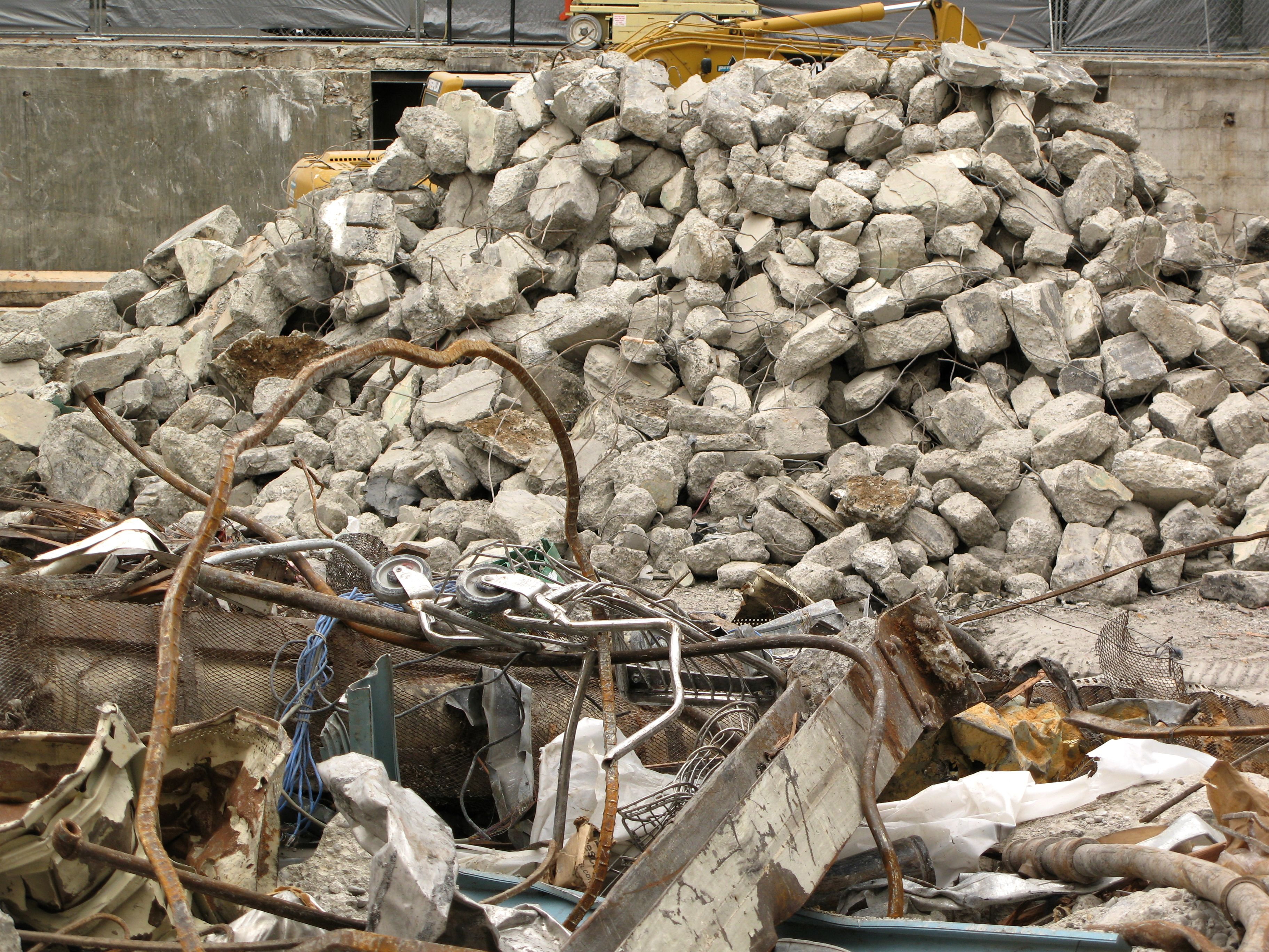 The cement rubble is segregated from the other piles of rubble.